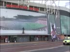 A sign featuring Wayne Rooney is removed from the outside of Old Trafford during the furore surrounding his possible leaving of the club and his new...