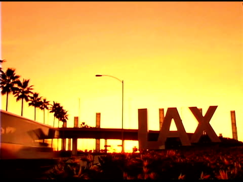 Sign for LAX Airport in Los Angeles, California at sunset