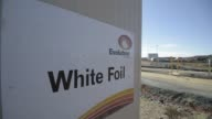 A sign for the White Foil open pit mine is displayed at an administration building of Evolution Mining Ltd's gold operations in Mungari Australia on...