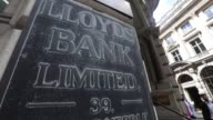 A sign hangs outside a Lloyds bank branch a unit of Lloyds Banking Group Plc in London UK on Friday Aug 4 2017