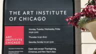 A sign hangs outside the Art Institute of Chicago on September 17 2014 in Chicago Illinois The museum which draws around15 million visitors a year...