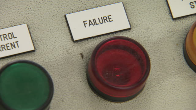 A sign identifies a red 'failure' light in an apple processing factory.