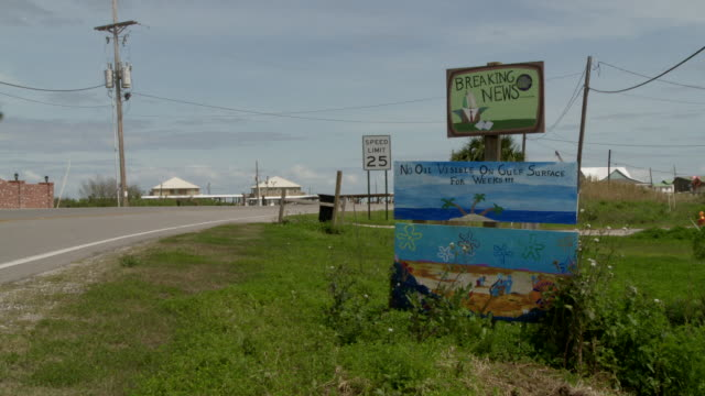 A sign in Grand Isle, Louisiana advertises oil-free waters.