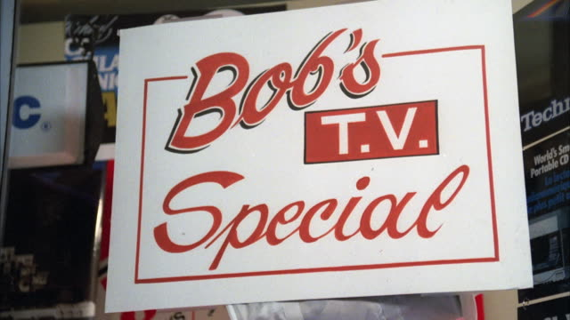 CU Sign in television and stereo shop window 'Bob's Television Special'