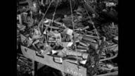 Sign 'Iron Scrap Steel' MS Crane w/ metal scraps moving over metal junk yard CU Alligator shears cutting metal pieces LA Wrecking ball 'Skull...