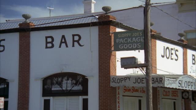 MS ZO Sign of sloppy joe bar on corner in small town