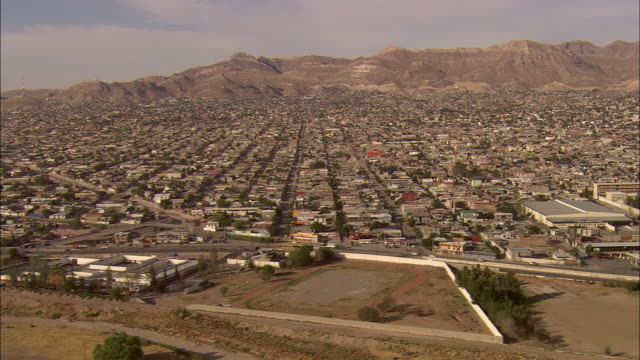 AERIAL ZO Sign on mountain reading 'The Bible is the truth' and city of Juarez with border crossing at El Paso, Juarez, Chihuahua, Mexico