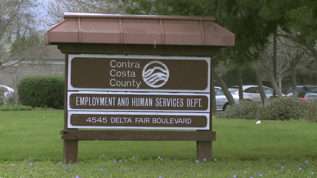 Sign outdoors on grass for 'Employment and Human Services Dept'/ Antioch California USA/ AUDIO