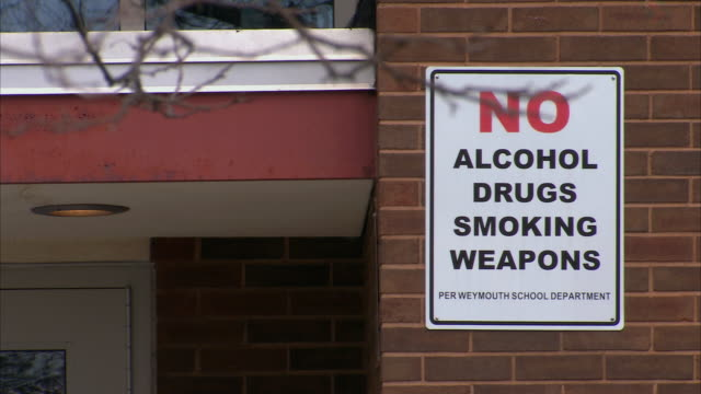 WS Sign reading No Alcohol Drugs Smoking Weapons near a school entrance / Weymouth, Massachusetts, United States