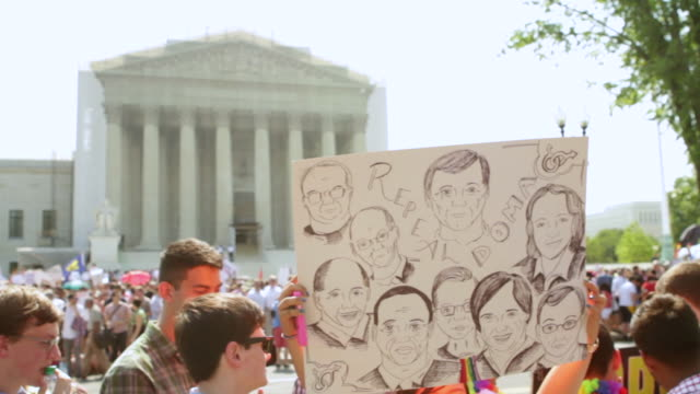 MS Sign showing caricatures of Supreme Court Justices during rally for marriage equality / Washington, District of Columbia, United States