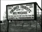 Sign that reads Colored Tourists Stop at Hotel McGuire / Richmond Virginia USA