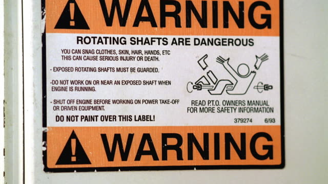 CU TU Sign that reads 'Warning Rotating Shafts Are Dangerous' / Georgetown, Texas, USA