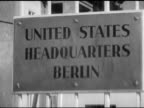 Sign 'United States Headquarters Berlin' VS Car passing through security at gates to US HQ in West Berlin security guard at gates American Sector...