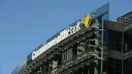 Signage for Commonwealth Bank of Australia is displayed atop the Commonwealth Bank Place building as traffic drive past in Sydney Australia on Monday...