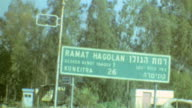 Signage for Golan Heights / Roads Leading Past Bunker / Shot of Yarmouk River / Sign warning of Land Mines / Ramat Hagolan on September 01 1974 in...