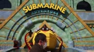 Signage for Submarine Adventure stands inside the Legoland Japan theme park in Nagoya Japan on Friday March 17 A lego display of a submarine stands...