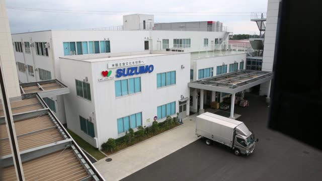 Signage for Suzumo Machinery Co is displayed at the company's factory in Kawashima Saitama Japan on Monday Aug 7 Close up signage reads We Love Rice...