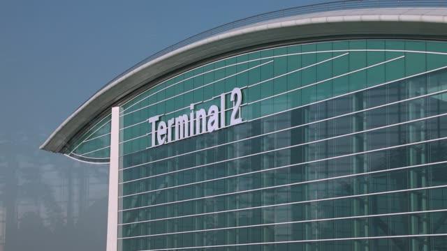 Signage for terminal 2 is seen atop the nearly completed terminal building during a media preview at Incheon International Airport in Incheon South...