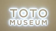 Signage for the Toto Museum operated by Toto Ltd is displayed on a window outside the museum in Kitakyushu Fukuoka Japan on Tuesday Jan 24 Toto Ltd...