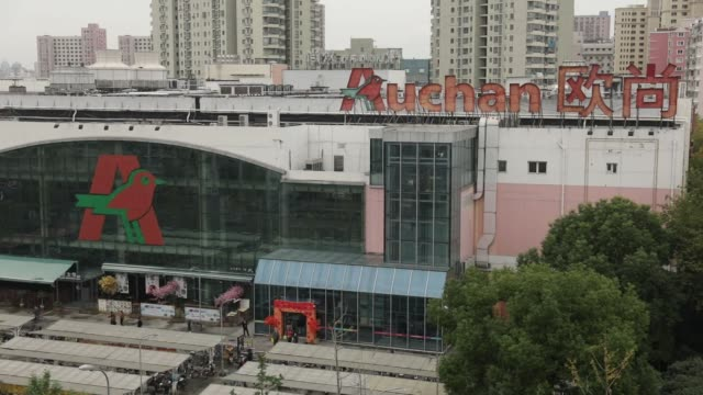 Signage is displayed atop an Auchan hypermarket operated by Sun Art Retail Group Ltd in Shanghai China on Monday Nov 20 Photographer Qilai...