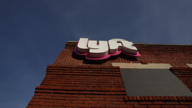 Signage is displayed outside of the Lyft Inc driver hub in Los Angeles California US on Monday November 13 2017 Photographer Patrick T Fallon Shots...
