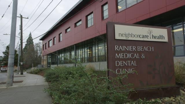 Signage 'neighborcare health Rainier Beach Medical and Dental Center' exterior clinic