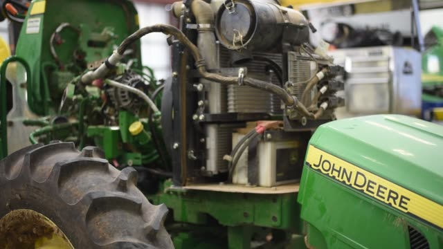 Signage on a John Deere Tractor at a maintenance garage in Waco TX on November 20 2017 Photographer Sergio Flores Shots focus in to front of tractor...
