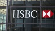 HSBC signage seen through window of HSBC Group global office headquarters at 8 Canada Square Low angle views of 8 Canada Square HSBC Group offices at...