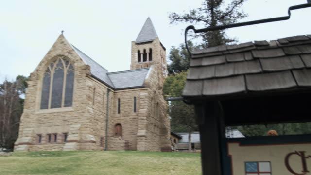 CU PAN WS Signboard and stone church, Pasadena, California, USA