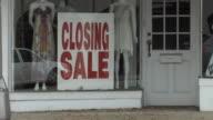 MS ZI Signs indicating clothing store is closing, Miami, Florida, USA