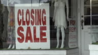 MS ZO Signs indicating clothing store is closing, Miami, Florida, USA