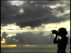 Sihouetted Photographer at Sunrise / Sunset