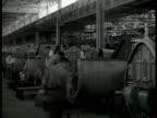 Sikorski Aircraft factory workers working on airplane part MS Workers carrying wing part LA WS Engineers working on engine motor WWII war production