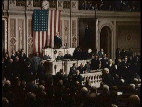 Silent stock footage of the Capitol in Washington DC / Cut to the House of Representatives / Members of the House applaud / An older couple browse a...