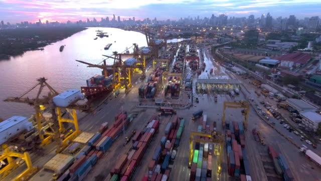 Silhouette cargo ship at dusk