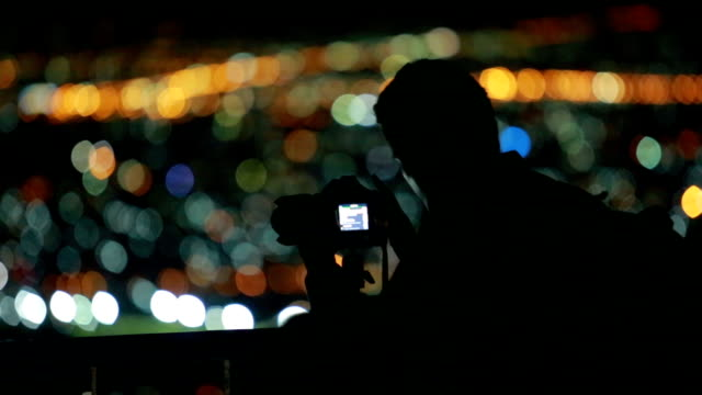 silhouette, night photo of photographer as take a photo