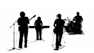 Silhouette of a band singing together