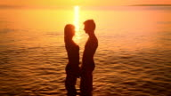 HD: Silhouette Of A Couple Kissing At Sunset