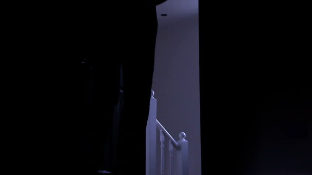 Silhouette of a man leaving dark room, left to right.