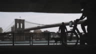 A silhouette of an unrecognizable cyclist riding through Lower Manhattan.