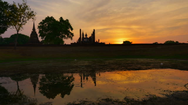 Silhouette of Buddha on sunset at Wat Mahathat Sukhothai Thailand
