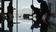 Silhouette of business people sitting down in meeting / Provo, Utah, United States,