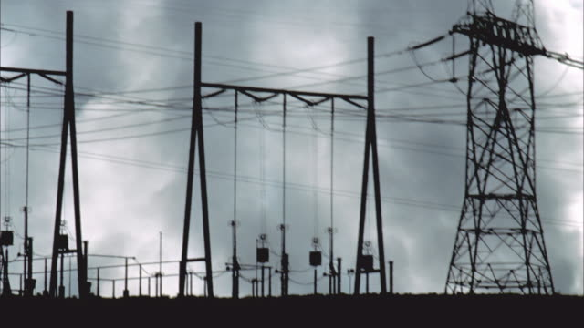 WS, PAN, Silhouette of coal-fired power plant, smoke in background, Page, Arizona, USA
