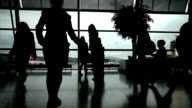 Silhouette of flight agents de bord discussed near a window at the airport