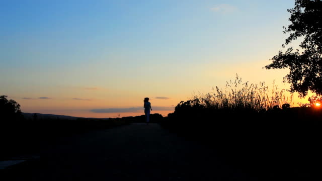 Silhouette of running woman.