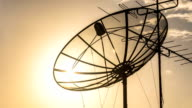 Silhouette of Satellite Dish at Sunset