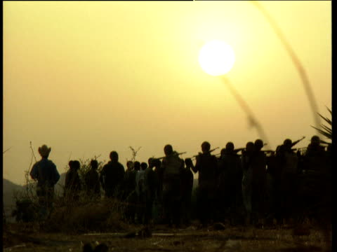 Silhouette of Sudan Peoples Liberation Army soldiers training in evening light