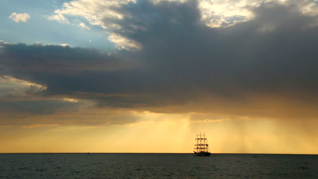 silhouette of the ancient sailing ship at sunset