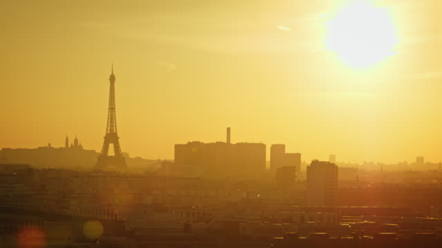 Silhouette of the Eiffel tower at sunrise