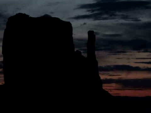 MS, ZO, Silhouette of West Mitten Butte at sunrise, Monument Valley Tribal Park, Arizona/Utah, USA